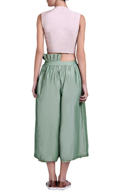 dusky pink blouse with green gathered pants