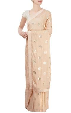 Peach sari with floral motif