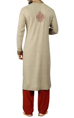 Cream kurta with maroon salwar