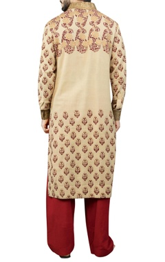 Cream printed kurta with maroon salwar