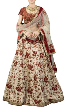 Cream lehenga set with red blouse