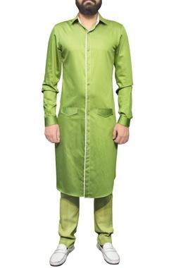 green shirt kurta with white piping
