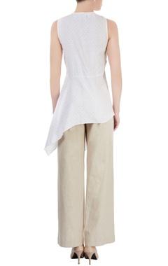 white polka dot tunic with asymmetric hem