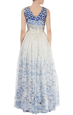 White gown with blue embellishment