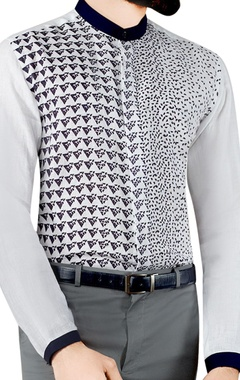white triangular printed shirt