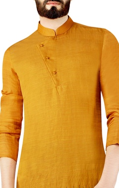 mustard yellow printed kurta completed with a collar