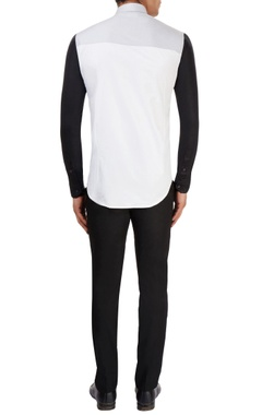 White shirt with black sleeves