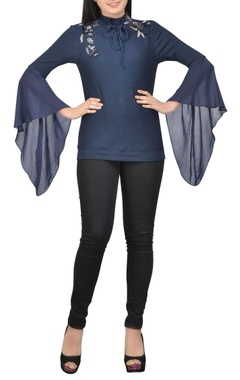 blue embellished top with draped sleeves