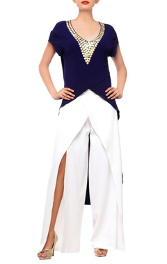 Blue embellished top with white pants