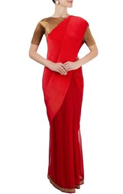 red pleated sari