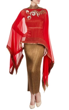 gold pleated dress with poncho