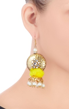 Gold earrings with yellow pom-pom