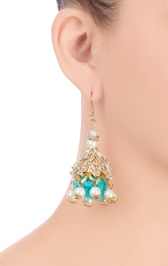 Gold finish jhumkas with blue pom-pom