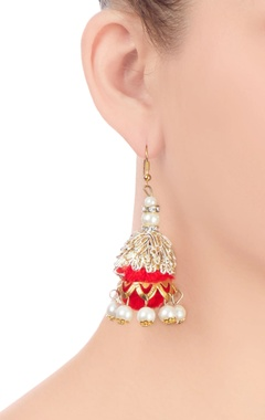 Gold finish jhumkas with red pom-pom