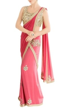 Coral pink sari with embellished blouse