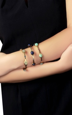 Gold plated bangle with green studs