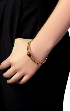 Gold plated bangle with multi colored studs
