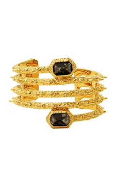 gold plated spiral hand cuff with black studs