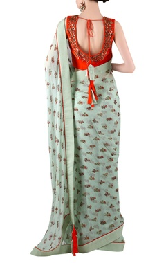 sage green printed sari with orange blouse