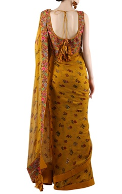 Mustard yellow embellished sari with print