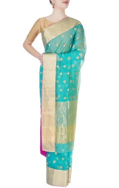 Turquoise mulberry silk sari with tanjore paintings