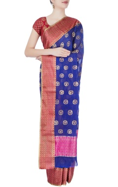 Royal blue woven sari with tanjore paintings