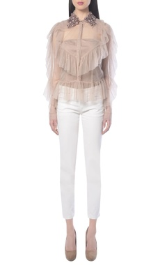 beige shirt with frills and embellishments