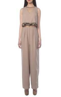 Beige jumpsuit with embellishments