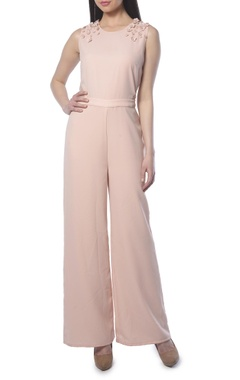 Light pink jumpsuit with floral embellishments
