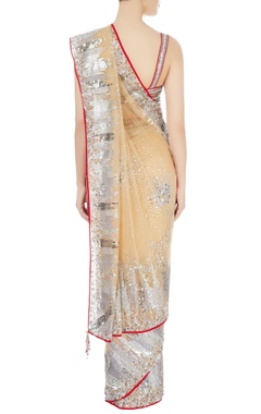 Beige embellished sari with red blouse