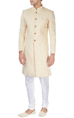 Beige achkan with gold buttons