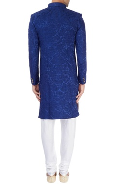 Blue achkan with gold buttons