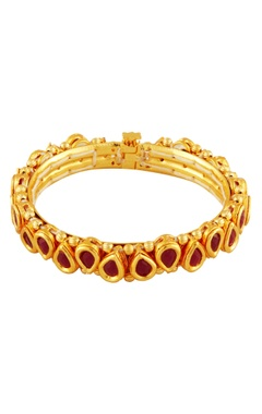 Gold bangle with red stones