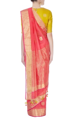 Peach printed sari with yellow blouse