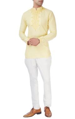 Yellow short kurta with white trousers