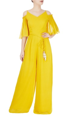 Yellow jumpsuit with beaded tassels