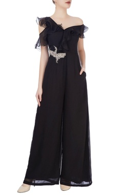 Black one-shoulder jumpsuit with applique