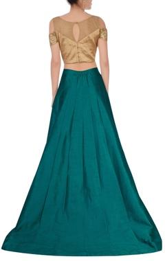 emerald green lehenga with gold blouse