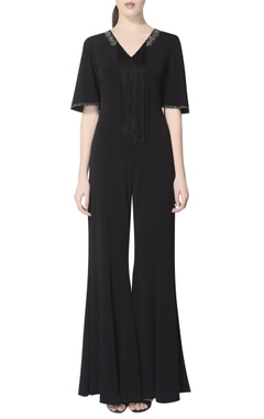 black jumpsuit with embellishments & fringes