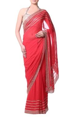 Peach sari with gold bugle embroidery