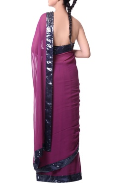 plum sari with stonework and blue sequence embroidery