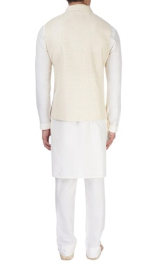 white kurta with cream nehru jacket