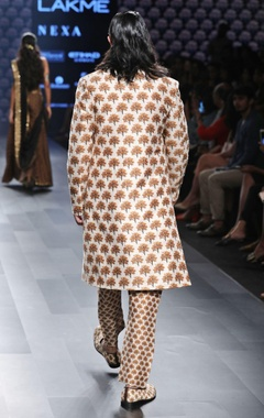 white sherwani in tree print