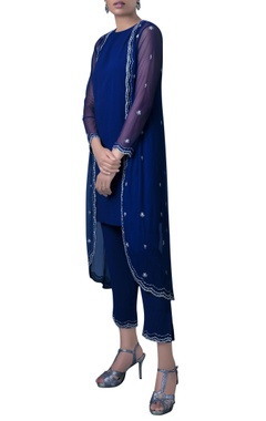 blue pants and jacket with embroidered details