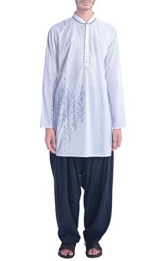 White kurta with thread embroidery.