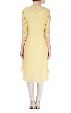Yellow embellished kurta & flared trousers