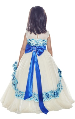 White gown with oversized blue bow