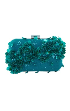 Blue clutch with three-dimensional motifs
