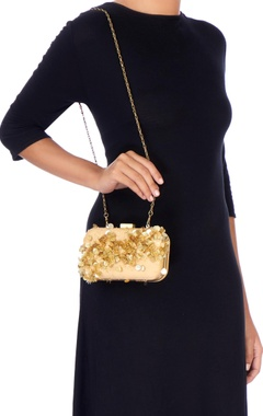 Beige clutch with gold sequin embellishments