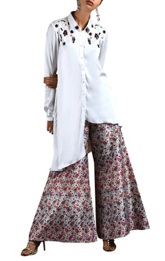 white asymmetric top & flared pants